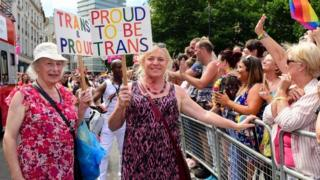 """Transgendered pensioner Margaret Pepper (formerly Maurice), 73 (L) holds a placard """"trans and Proud"""" as she takes part in London Pride parade in London, Britain, 08 July 2017."""
