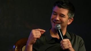 Uber co-founder Travis Kalanick gestures as he speaks at an event in New Delhi on December 16, 2016
