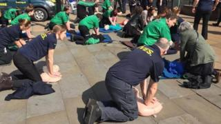 People learning CPR in Lincoln city centre