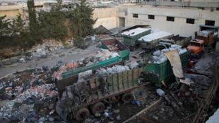 Aid is seen strewn across the floor in the town of Orum al-Kubra on the western outskirts of the northern Syrian city of Aleppo on Septmber 20, 2016, the morning after a convoy delivering aid was hit by a deadly air strike