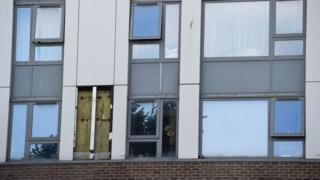 Cladding removed from tower