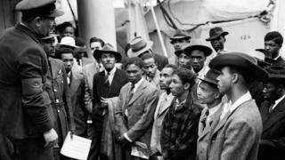 "Jamaican (West Indian) immigrants welcomed by RAF officials from the Colonial Office after the ex-troopship HMT ""Empire Windrush"" landed them at Tilbury"