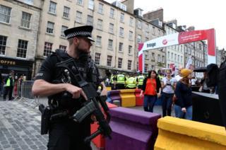 Armed officer at Fringe