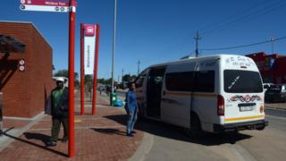 A minibus taxi waits for passengers on 24 August 2014 outside South Africa's first taxi rank to be considered 'green' in Wallacedene, about 35 km from the centre of Cape Town.