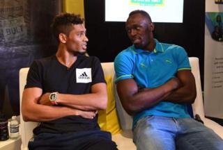 Wayde van Niekerk(kushoto) Usain Bolt(kulia)