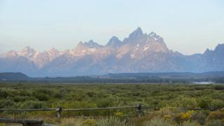 The sun rises over Grand Teton National Park on August 21, 2017 outside Jackson, Wyoming.