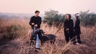 Prince Cyrus with his sister Princess Sakina and their dogs