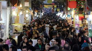 Iranians shop in Tehran's ancient Grand Bazaar