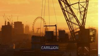 Construction crane in central London with Carillion banner on it