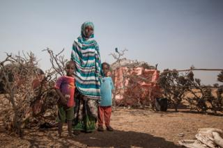 Khadra Mohamed with her twin sons at an informal settlement outside the town of Yogoori