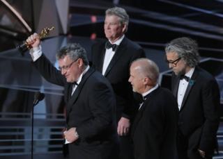 John Nelson, Paul Lambert, Richard R. Hoover and Gerd Nefzer accept their Oscar onstage