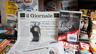 """Il Giornale newspaper is seen on sale in a newsstand with Hitler's """"Mein Kampf"""", in Rome Saturday, June 11, 2016."""