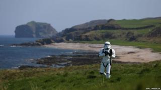 Star Wars fan John Joe McGettigan in stormtrooper costume walking along the Donegal coast