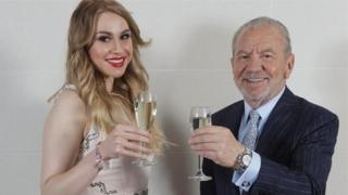 Alana Spencer toasts her Apprentice victory with Lord Sugar in December last year