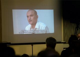 ) In this photograph taken on March 29, 2016, Pakistani journalists watch a video showing Indian national Kulbhushan Yadav, arrested on suspicion of spying, during a press conference in Islamabad