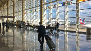 A traveller walks through the Washington DC airport