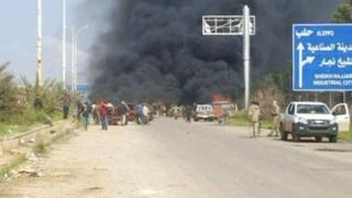 Smoke billows over coaches after bomb attack