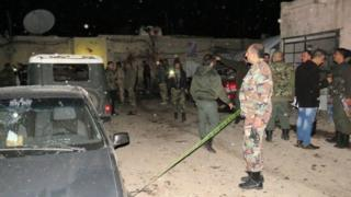 Syrian soldiers gather at the site of an attack in Kafr Sousa (12 January 217)