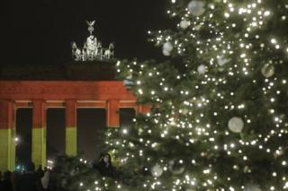 The Brandenburg Gate is illuminated in the colours of the German flag in Berlin, Germany, 20 December