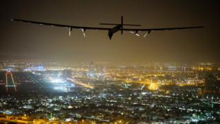 Solar Impulse 2, a solar-powered airplane, piloted by Swiss pioneer Bertrand Piccardis seen as it lands in Abu Dhabi