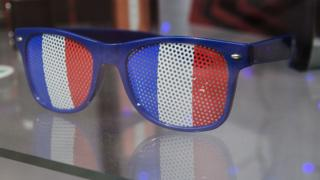A pair of sunglasses in the colours of the French flag