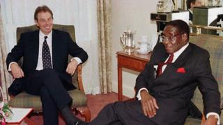 Tony Blair and Robert Mugabe in 1997