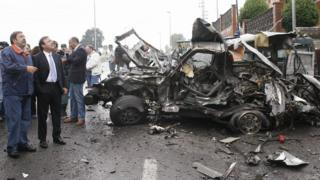 Spanish officials visit the scene of a bomb attack outside a Civil Guard barracks in the Basque region in August 2007