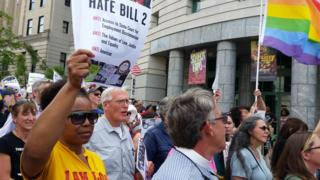 Protesters march to show their opposition against what they called 'Hate Bill 2', which they urged lawmakers to repeal as legislators convened for a short session in Raleigh, North Carolina April 25, 2016