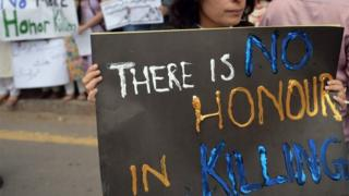 Pakistani human rights activists hold placards during a protest in Islamabad on May 29, 2014 against the killing of pregnant woman Farzana Parveen was beaten to death with bricks by members of her own family for marrying a man of her own choice in Lahore.