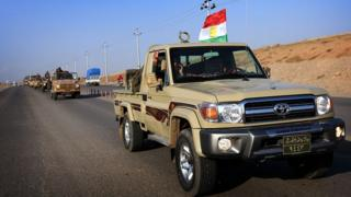 Курдские ополченцы на пути к Кобане.
