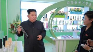 Kim Jong Un holds a hairspray can