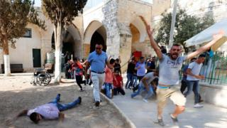 Muslims celebrate as they re-enter a holy site in East Jerusalem