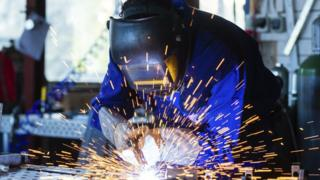 Welder with sparks flying