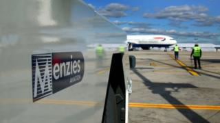 Menzies Aviation logo at airport terminal