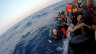 People on a sinking boat in the Mediterranean
