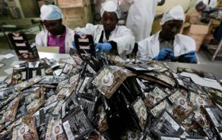 Workers pack coffee sachets at the Dormans coffee factory in Nairobi, Kenya, 29 July 2016. Dormans coffee factory started roasting coffee in 1950, making it the oldest and one of the largest coffee factory in Kenya, according to a senior worker at the company