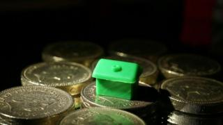 Monopoly piece on coins