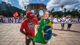 People take part in a demonstration in defence of democracy and the right of former president Luiz Inacio Lula da Silva (PT) to be a candidate in the next national elections, in Porto Alegre in southern Brazil on January 13, 2018.