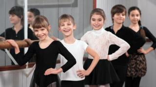 Boys and girls at ballet barre