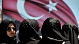A woman looks on during a demonstration in support of Turkey's President Erdogan (not pictured) at the Sarachane park in Istanbul on July 19, 2016.