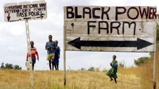 "Schoolchildren by a farm 40km east of Harare, renamed ""Black Power Farm"" by war veterans who have taken it over - 21 June 2000"