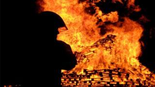 Firefighter tackles a blaze