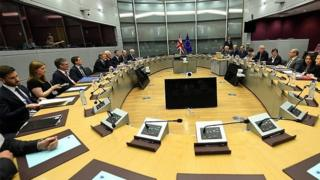 British and EU officials on the first day of Brexit talks last month