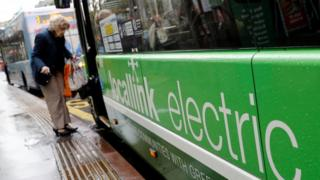 Passenger boards electric bus