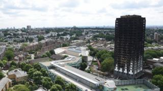 Exterior view of charred outer walls of the burnt out shell of the Grenfell Tower