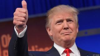 Republican presidential candidate Donald Trump gives a thumbs-up.
