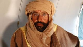 Saif al-Islam Gaddafi is seen sitting in a plane in Zintan November 19, 2011