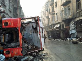 an overturned bus in Judaydah
