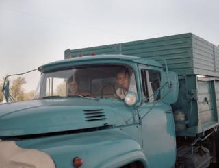 Men sit in a blue lorry