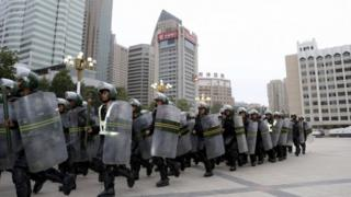 Armed paramilitary policemen run in formation during a gathering to mobilize security operations in Urumqi, Xinjiang Uighur Autonomous Region, in this June 29, 2013 file photo.